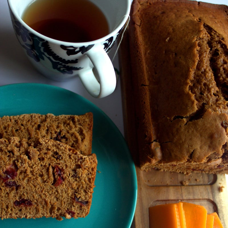 easter spice bread on a table with a cup of tea