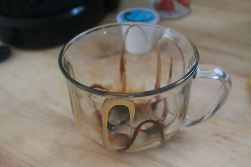 glass with chocolate syrup and caramel