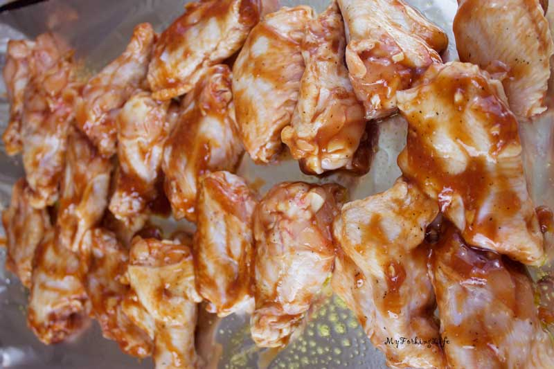 marinated chicken on baking sheet