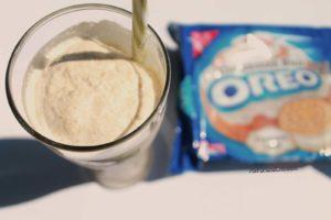 oreo milkshake with straw sticking out and oreos on side