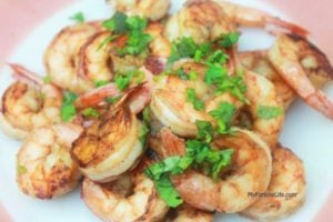 shrimp on plate with cilantro on top