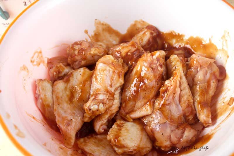 chicken wings covered in sauce in bowl