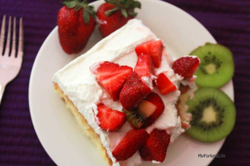 This Tropical Tres Leches Cake is a delicious spin on the traditional recipe. Add any fruit you desire to the top. Great dessert recipe.