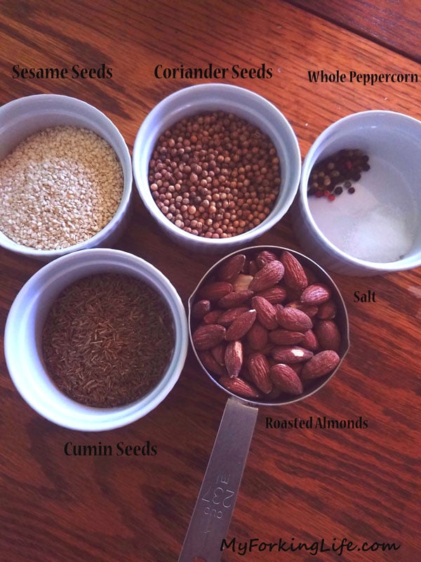 spices and nuts in ramekins on table
