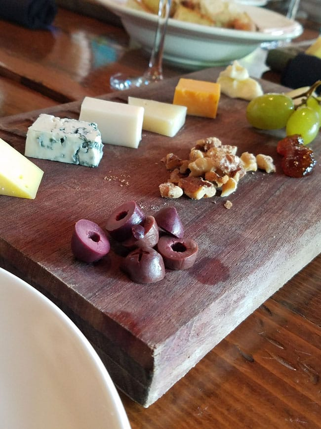 cheese, nuts, olives on board