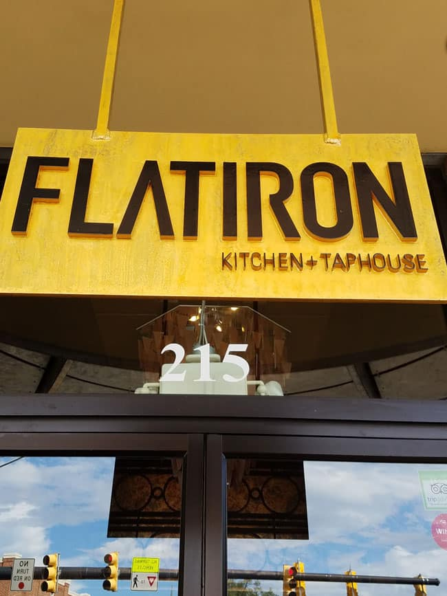sign of flatiron kitchen and taphouse