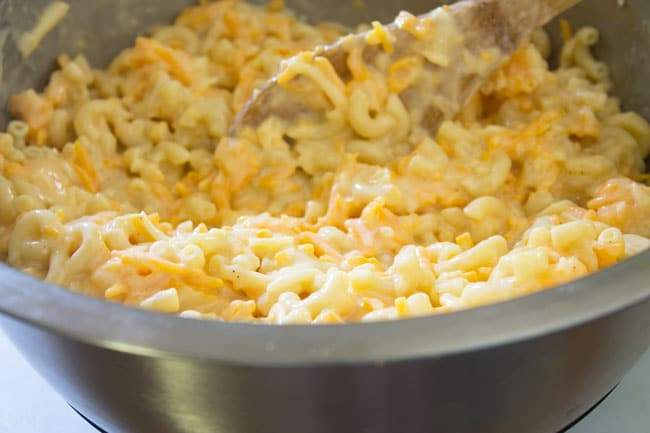 creamy baked macaroni and cheese in steel bowl