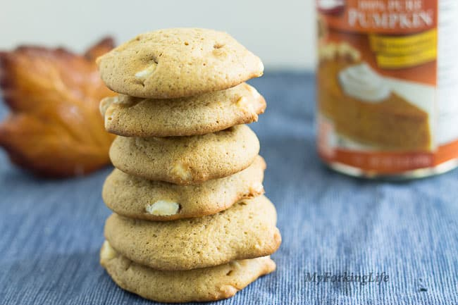pumpkin cookies stacked on top of each other