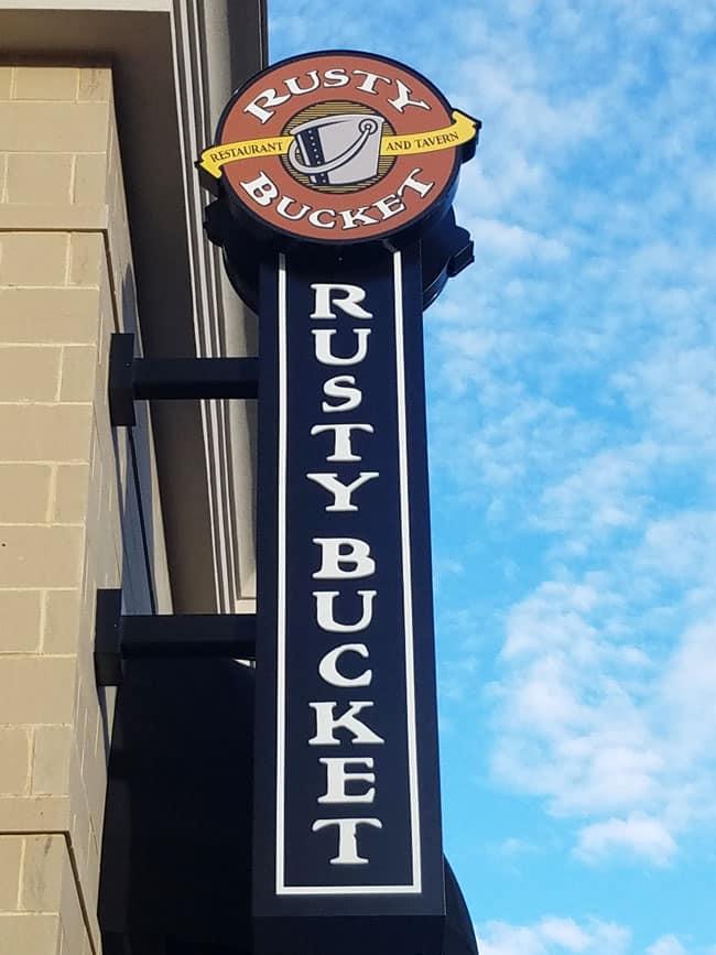 sign of rusty bucket