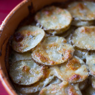 Scalloped potatoes with blue cheese. Side dish. Potatoes au gratin.