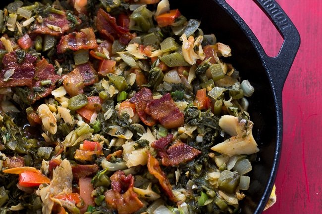 Callaloo in and saltfish in cast iron skillet