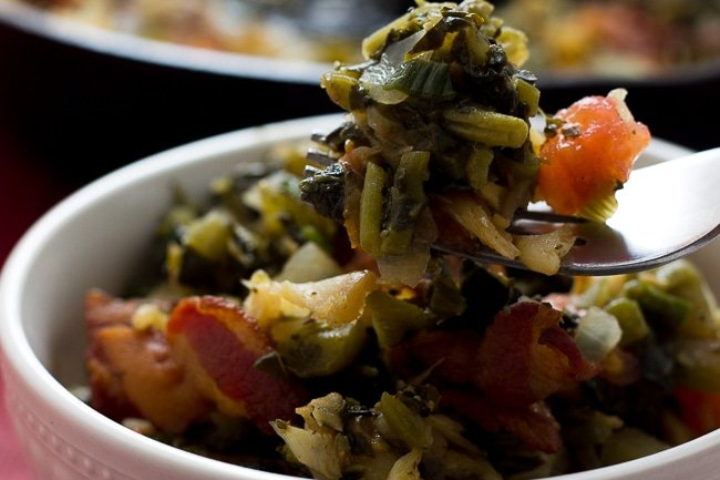 callaloo and saltfish on a fork