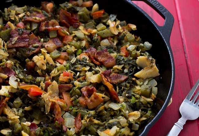 callaloo and saltfish on a skillet