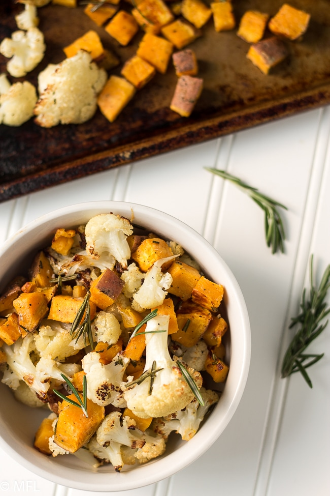 Roasted Cauliflower and sweet potato recipe. Great easy and healthy side dish. Sheet pan sides are perfect for dinner. Vegetarian sides. Gluten free. Vegan.