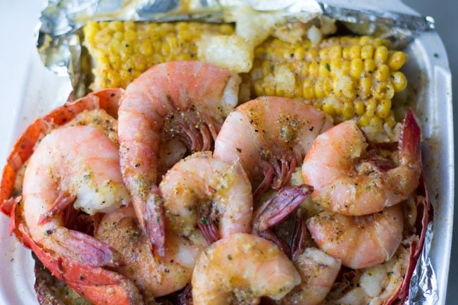 seafood shrimp, corn in container