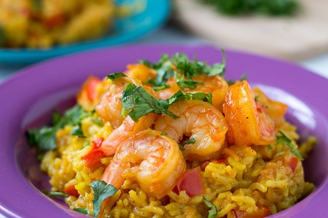 pressure cooker shrimp paella on a purple plate