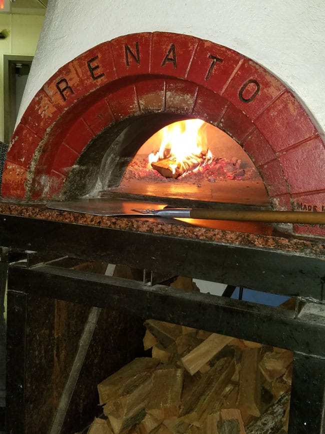 wood fire oven with wood pieces under it