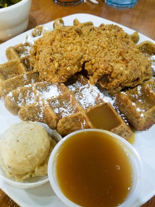 Dame's Chicken and waffles on a white plate