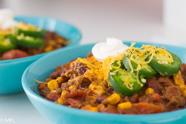 pressure cooker turkey chili in blue bowl
