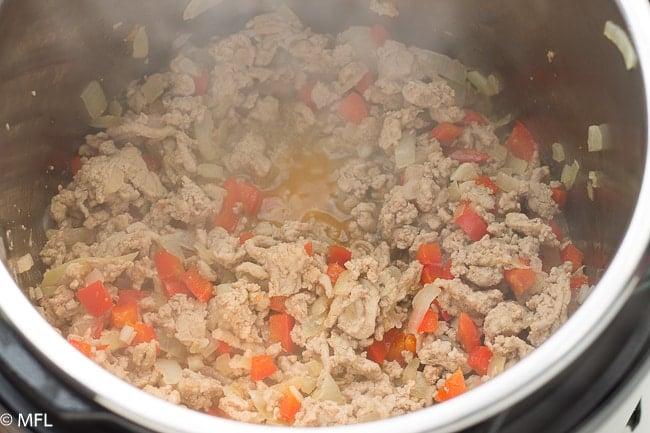 ground turkey cooking in pot
