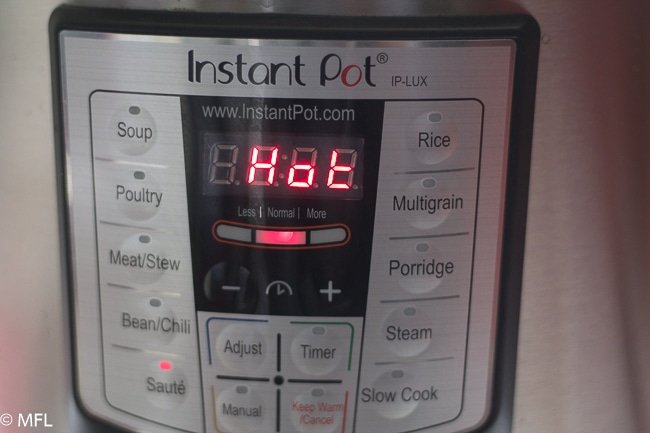 instant pot display with the word HOT on the screen