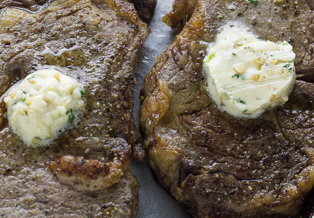 Perfect Air Fryer Steak with Garlic Herb Butter. Create the perfect steak in your air fryer. Tried and true method of creating juicy and delicious steak. #airfryerrecipes #airfryer #airfryersteak #ribeye #ribeyesteak #flavouredbutter #garlicherbbutter #delicioussteak @airfryerrecip