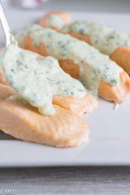 This Pressure Cooker Salmon is perfect for a quick meal in the Instant Pot. Top it with a creamy herb parmesan sauce for a quick and fancy meal that is ready in less than 20 minutes. #instantpot #quickdinner #salmonrecipe #pressurecookersalmon #myforkinglife