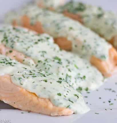 This 5 Minute Pressure Cooker Salmon is perfect for a quick meal in the Instant Pot. Top it with a creamy herb parmesan sauce for a quick and fancy meal. #instantpot #quickdinner #salmonrecipe #pressurecookersalmon #myforkinglife
