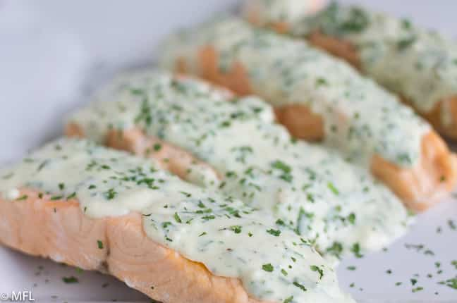 salmon with herb on top