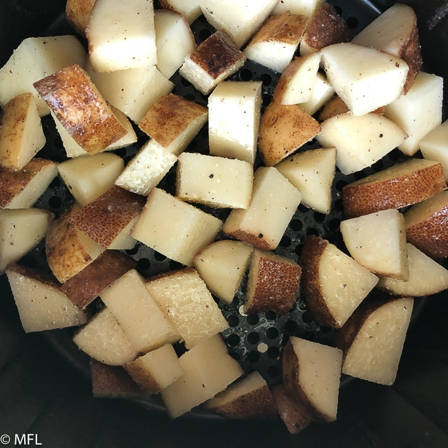 These Breakfast Air Fried Potatoes are crispy on the outside and tender on the inside, just how breakfast potatoes should be. Step by step photos included to get the perfect breakfast potatoes in the air fryer. #airfryer #healthy #airfriedpotatoes #easy #airfryerrecipes #myforkinglife #airfryerfries