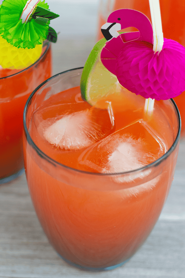 rum punch in glass with flamingo on top