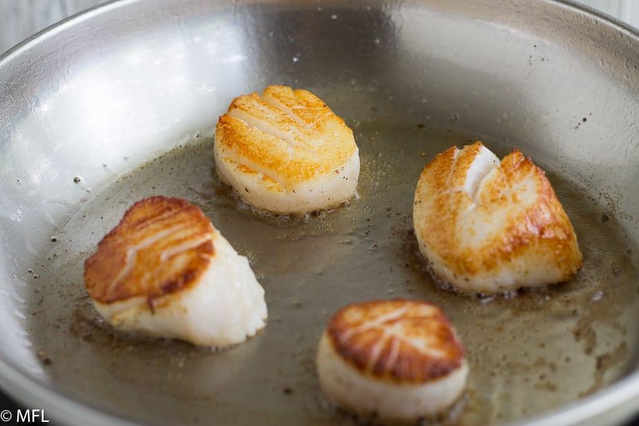 seared scallops in skillet