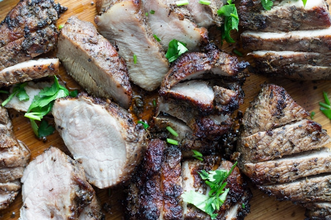 air fryer jamaican jerk pork recipe on a cutting board. This Air Fried Jamaican Jerk Pork Recipe is delicious and flavorful. Only 2 ingredients and easy to make for an easy weeknight dinner. Have a taste of the Caribbean with this tried and true method. #airfryer #airfryerrecipes #Jamaicanrecipes #Caribbeanrecipe