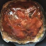 Meatloaf in Air Fryer with glaze on top.