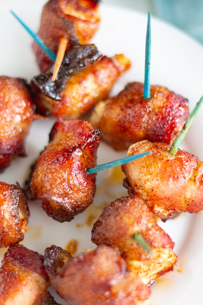 This Air Fryer Bacon Wrapped Chicken is covered in a sweet and spicy rub for a quick and easy appetizer. With only 5 ingredients, this recipe is easy, delicious, and a perfect delicious appetizer. #airfryer #airfryerrecipe #bacon #chickenbites #baconwrappedchicken #gametimerecipe