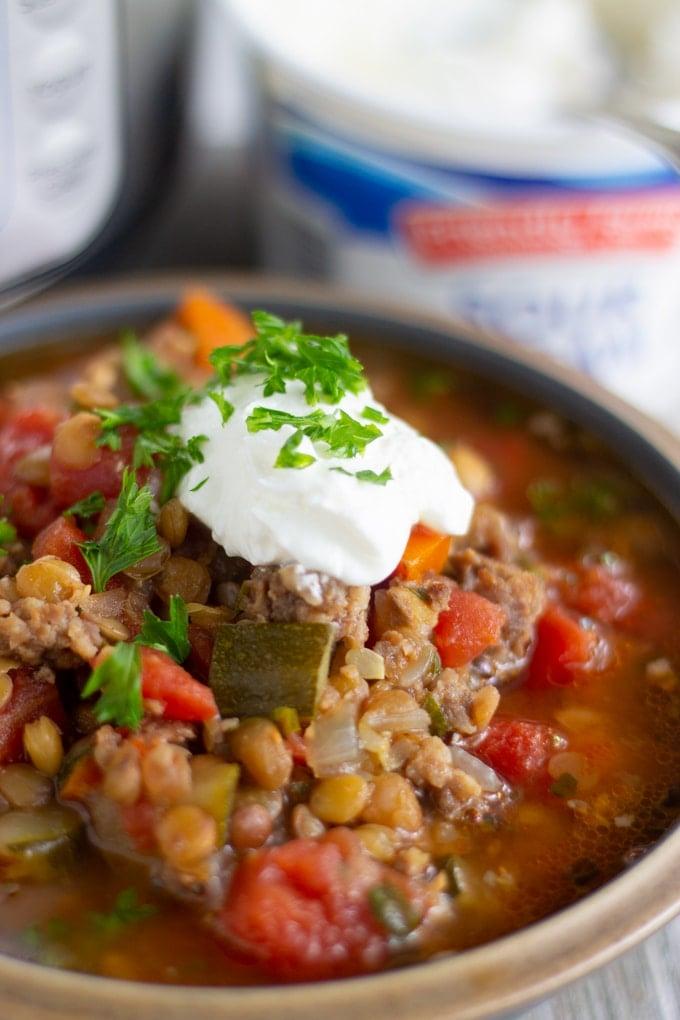 final shot of pressure cooker lentil soup in a bowl