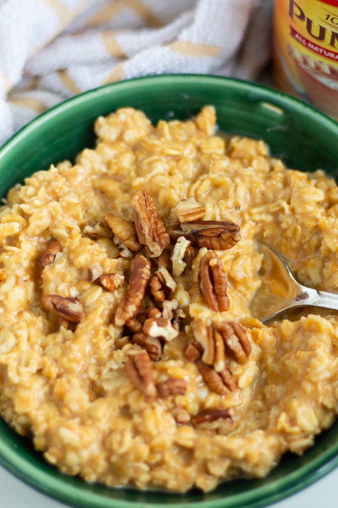 oatmeal in bowl with walnuts on top