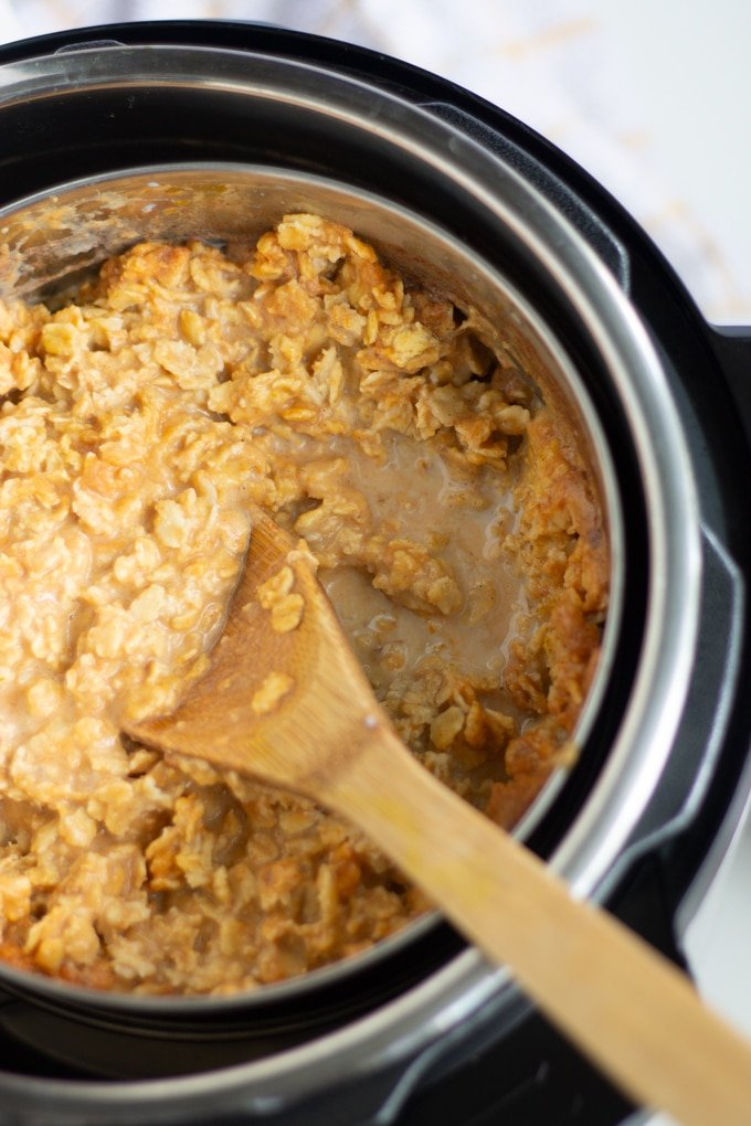 This Creamy Pressure Cooker Pumpkin Pie Oatmeal is a delicious spin on traditional oatmeal. Make this quick and easy delicious breakfast in your Electric Pressure Cooker any day of the week. #instantpot #breakfast #pressurecookerbreakfast