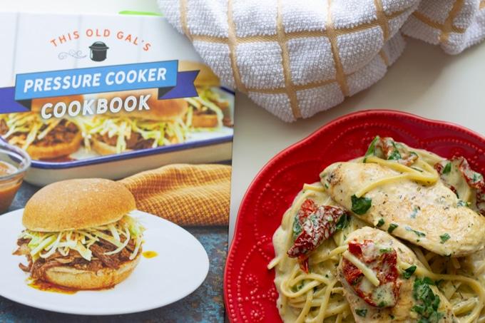chicken dish next to cookbook