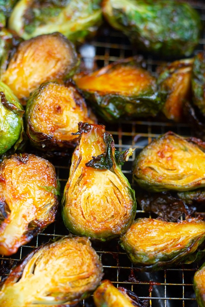 These Sweet and Spicy Air Fryer Brussel Sprouts come out perfect when cooked in your Air Fryer. Toss them in a Korean style sauce for the perfect vegetable side dish. #airfryerrecipe #airfryer #airfryervegetablesr