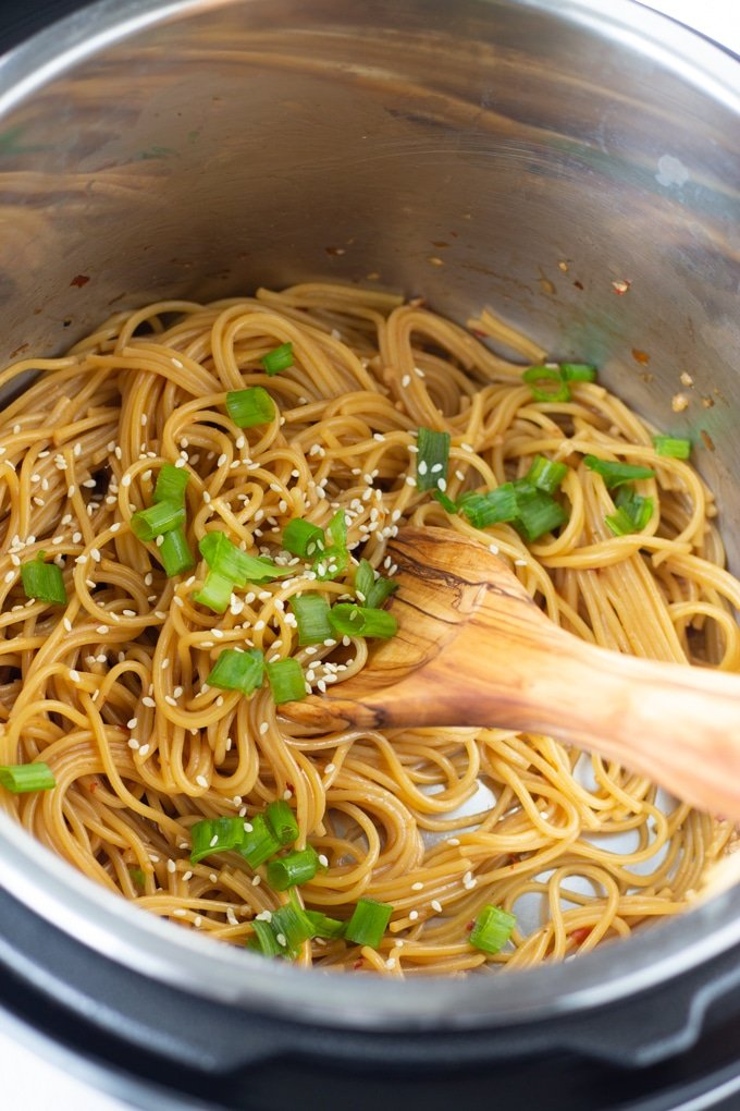 Easy and delicious one pot Garlic noodles made in the Instant Pot. No draining needed to make this delicious Asian inspired noodle recipe. #asian #recipes #instantpotrecipes #pressurecooker #onepotmeal #instantpot