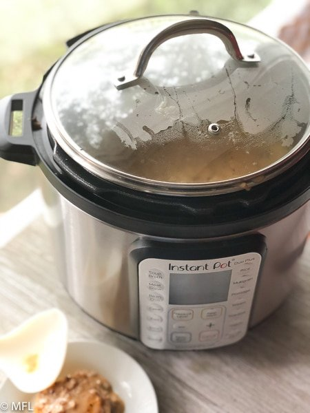 instant pot covered with glass lid near window