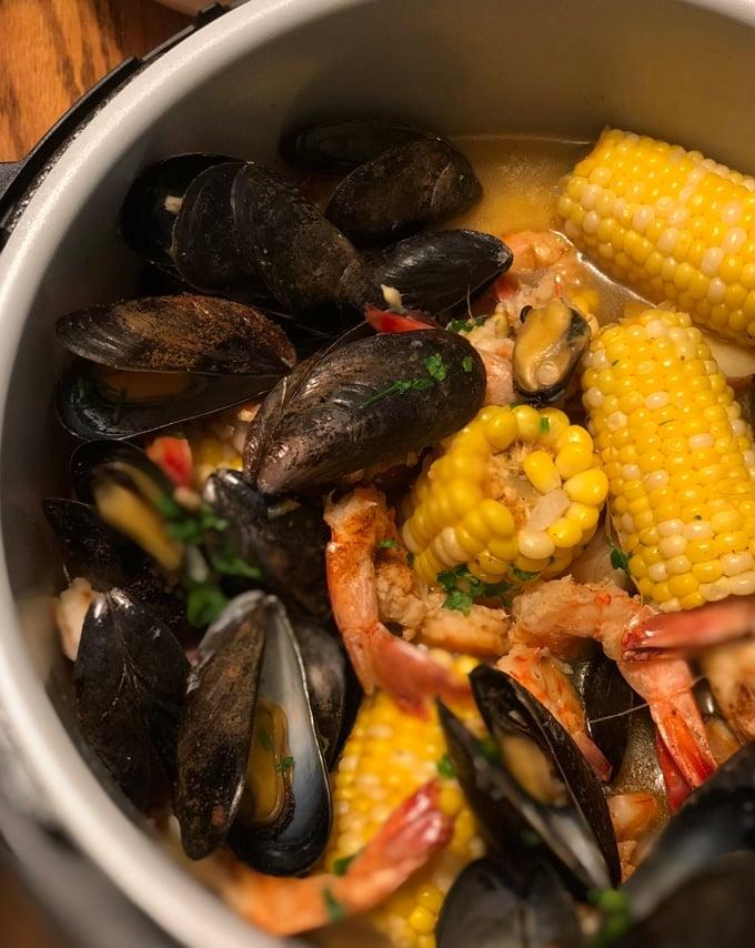 ninja foodi shrimp boil inside insert with mussels and corn and shrimp