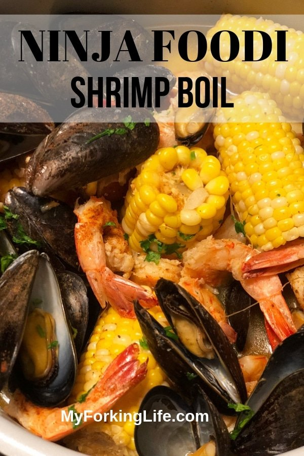 This Ninja Foodi Shrimp Boil recipe is delicious, quick, and easy. Made with a delicious blend of spices and dipped in garlic butter for the perfect meal. #ninjafoodi #ninjafoodirecipe #shrimpboil