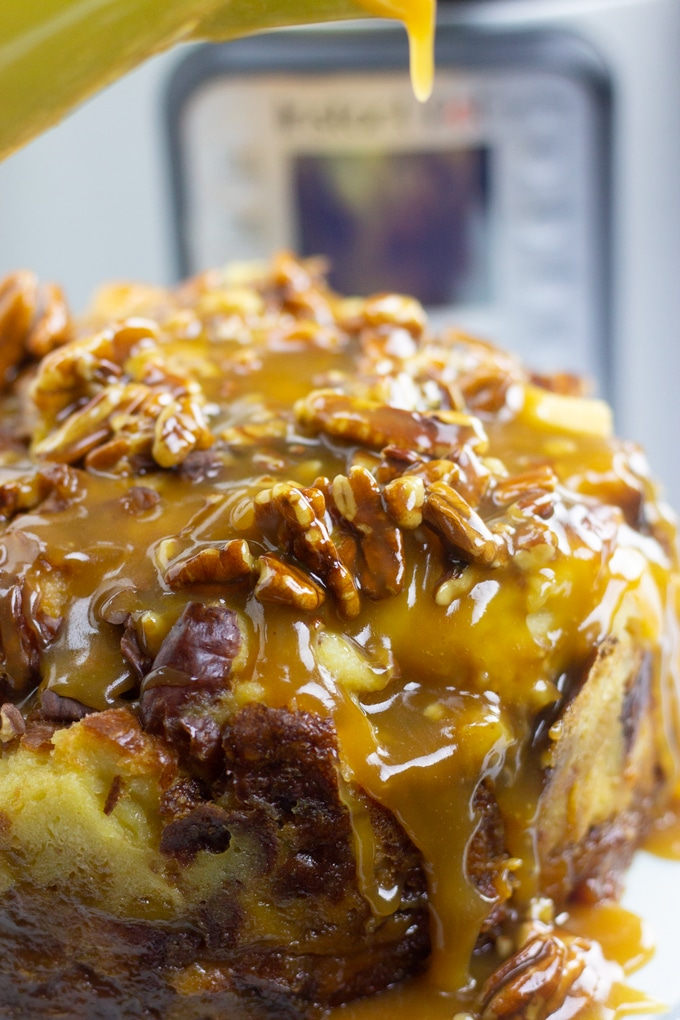 caramel glaze being poured over instant pot bread pudding