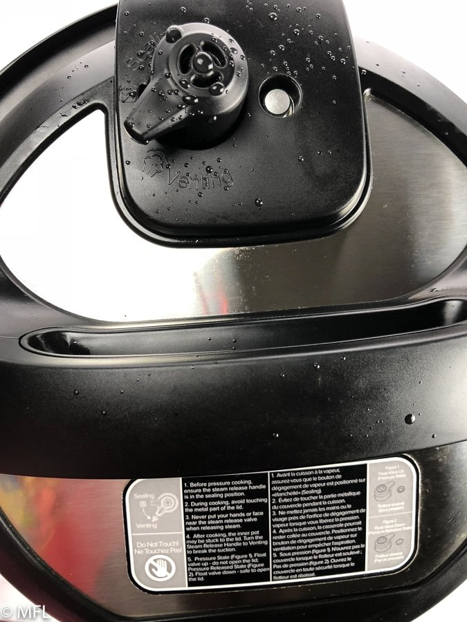 "Top of Instant Pot cover set to ""Venting"""