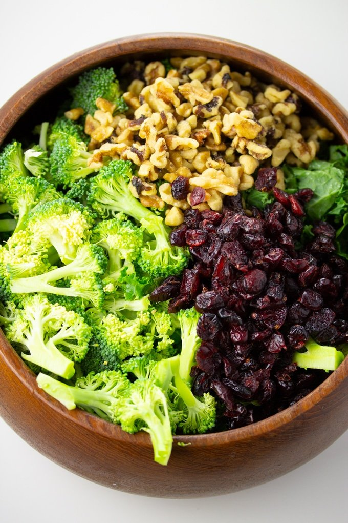 broccoli, cranberries, and walnuts in bowl