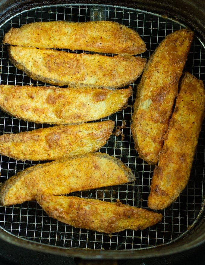 finished air fryer potato wedges in air fryer basket