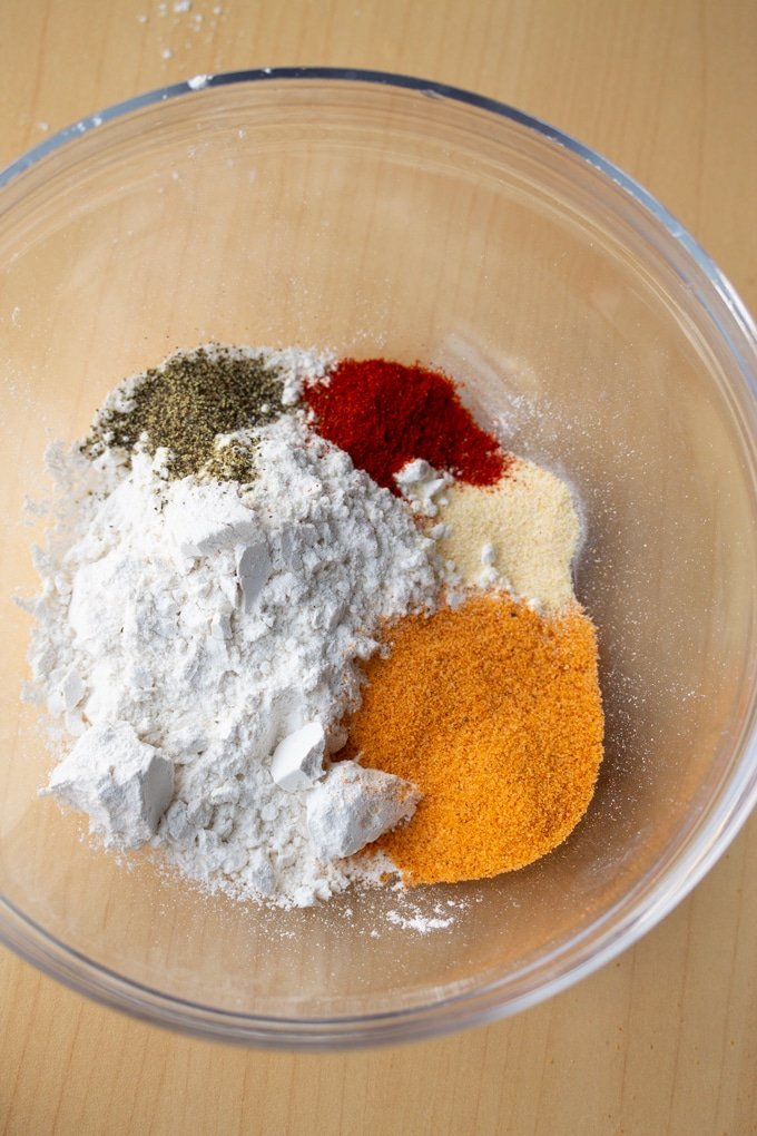 flour and seasoning placed in a bowl