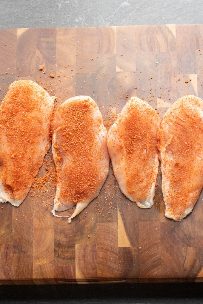 raw chicken with bbq seasoning on it